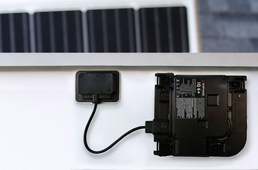 Enphase IQ 6+ Microinverter mounted on solar panel