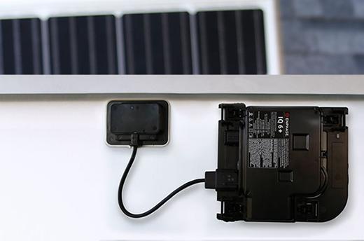 Enphase IQ 6+ Microinverter mounted on solar panel
