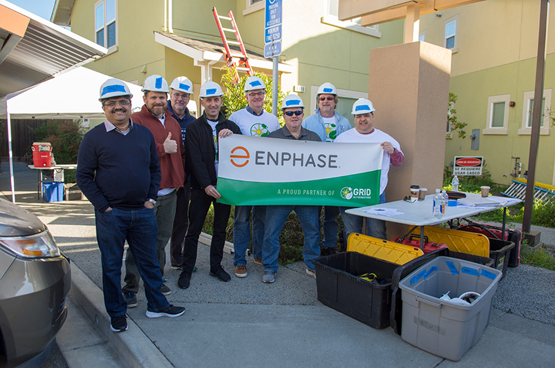 Enphase team installing solar panels with GRID Alternatives