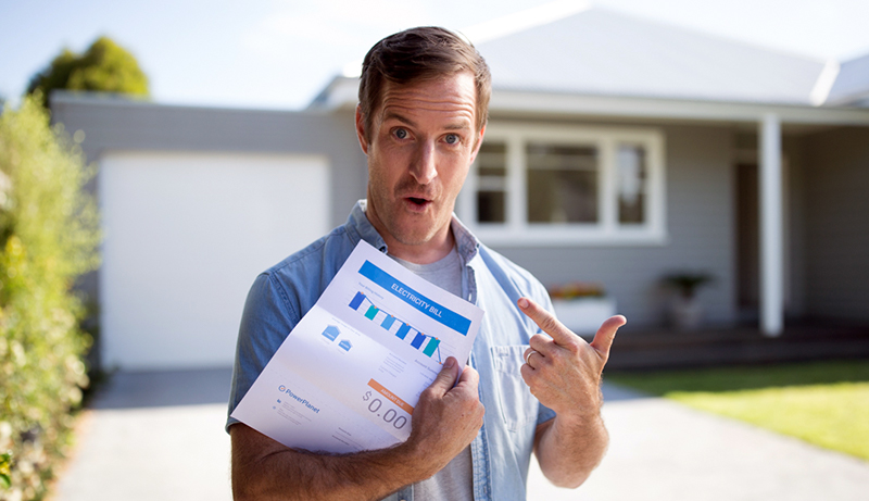 Man holding electricity bill