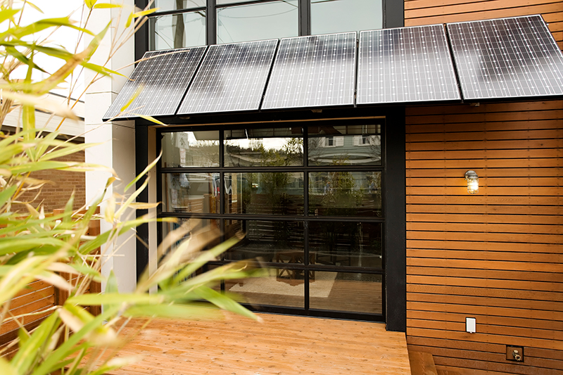 Home with solar panels as awning