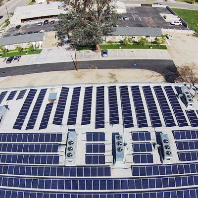 Aerial photograph of large solar installation with many solar panels and microinverters