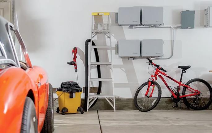Image of Enphase solar batteries installed in a homeowner's garage